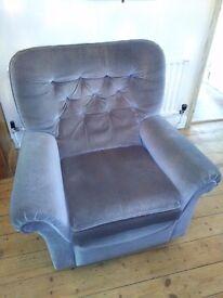 Grey velour reclining arm chair