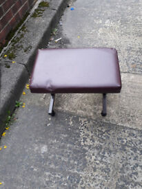 small metal framed stool with leather padded seat