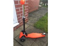 Child's three wheel scooter