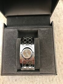 Genuine Gucci watch with Original box very good condition