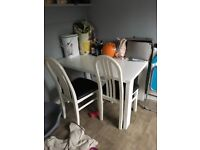 White gloss table with two chairs