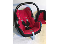 Maxi Cosi Cabriofix car seat in red/black and Maxi Cosi Easyfix isofix base.
