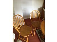 Solid pine extendable dining table and four chairs