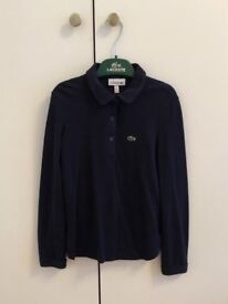 Lacoste girls navy polo top , size 8 yr old, hardly used