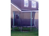 12ft trampoline with pads and safety net, great condition!