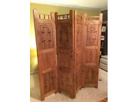 Beautiful carved wooden screen/room divider.