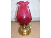 Antique Victorian oil table lamp with pineapple cranberry glass shade.
