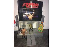 WWE wrestling stage and three wrestlers