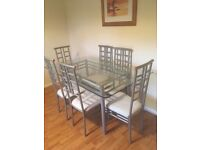 Silver And Glass 6 Seater Dining room table and chairs with cream upholstery & matching coffee table