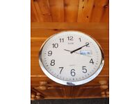Large Wall Clock... for the kitchen most likely? With Day and Date too.