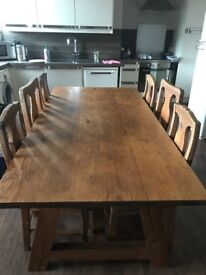 Solid wooded dining table and six chairs.