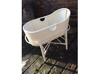 Vintage cream colours whicker cot on stand with coaster wheels