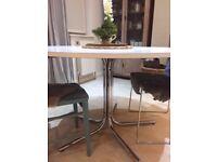 round white table chrome legs about metre diameter