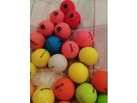 Various golf balls.