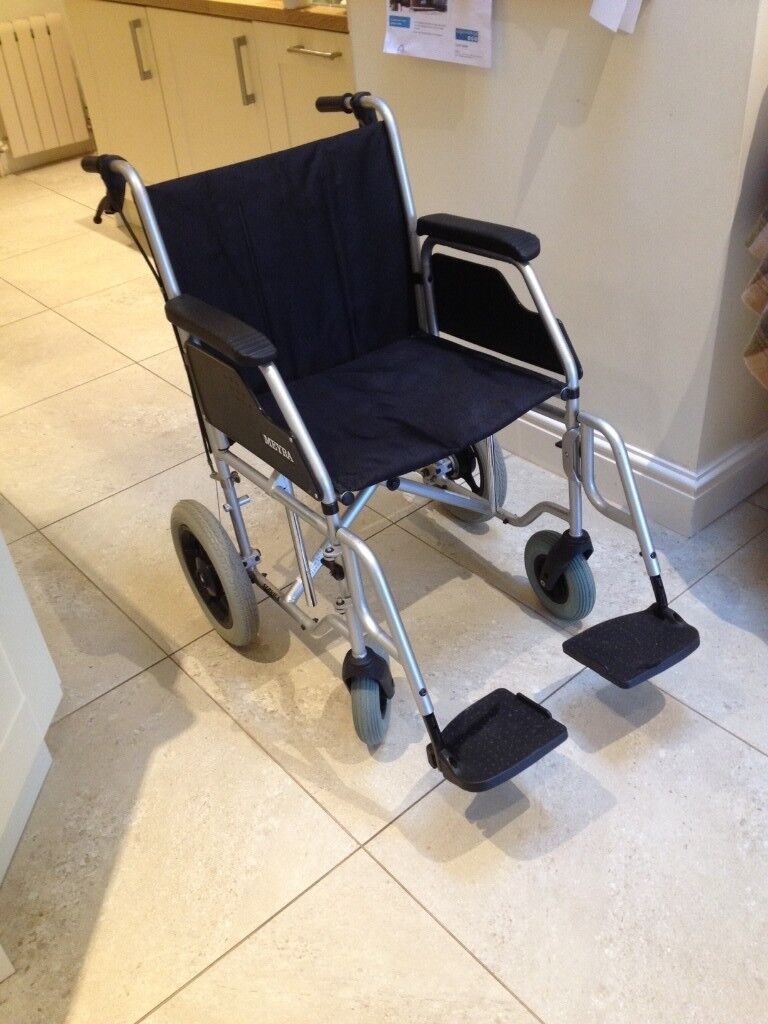 Carer's wheelchair. Folding for easy transport. Suited for visiting relatives. Excellent condition.