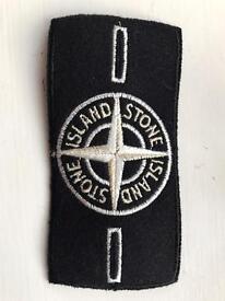 White stone island badge