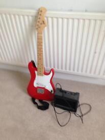 Electric guitar, amp and original box