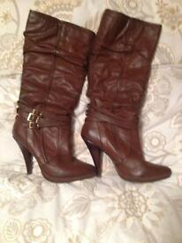 Brown high heeled knee boots
