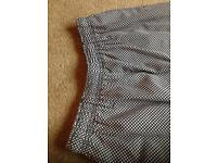 Chequered chef trousers.