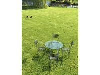 Stunning Tom Dixon garden table and chairs. Metal and glass 100cm round table and 4 chairs.
