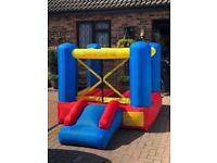 Childrens Bouncy Castle approx 6x6 ft complete with electric blower used once