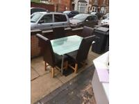 Lovely solid extendable dining table with 4 leather chairs