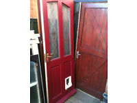 Exterior hardwood door with frosted patterned glass and catflap