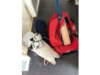 Junior cricket gear with bat and bag