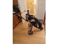 Full Set of Titleist Golf Clubs, TaylorMade Driver, Wilson Hybrids, Putter, Bag and 3 Wheel Trolley