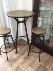 Brand New Bistro Style Table and Two Matching Stools.