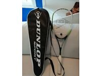 Two squash racquets plus covers for sale .