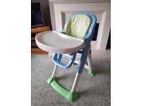 High chair with straps and removable tray.
