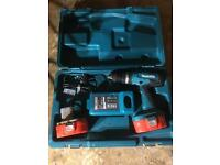 Makita combi drill with 2 batteries