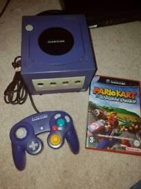 Purple Nintendo gamecube and Mario kart