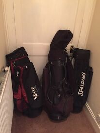 26 various golf clubs and 3 bags