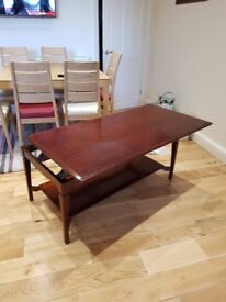 Coffee Table converts into a supper table so can eat sat on sofa. A little water damage on top.