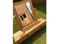 Sold wood mirror & drawers.