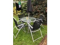 Garden table + 4 chairs and for free 4 new pillows