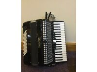 Piano Accordion. chanson 96 base. Black. Used but in first class condition.