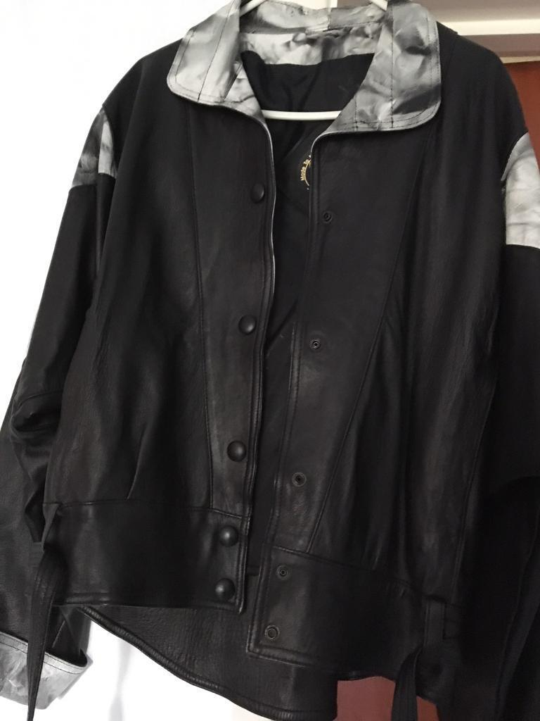 Black and white real leather jacketin Crawley, West SussexGumtree - Black and white real leather jacket.. size 10. New and unworn.. can be collected from Turners Hill area