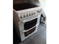 60cmdouble oven electric cooker in spotless well looked after condition,12 months old cost £549.