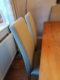 Next table and 6 leather chairs c/w 2 extension pieces.