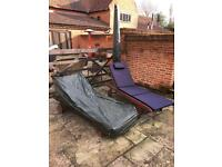 Two wooden lounge chairs with new cushions