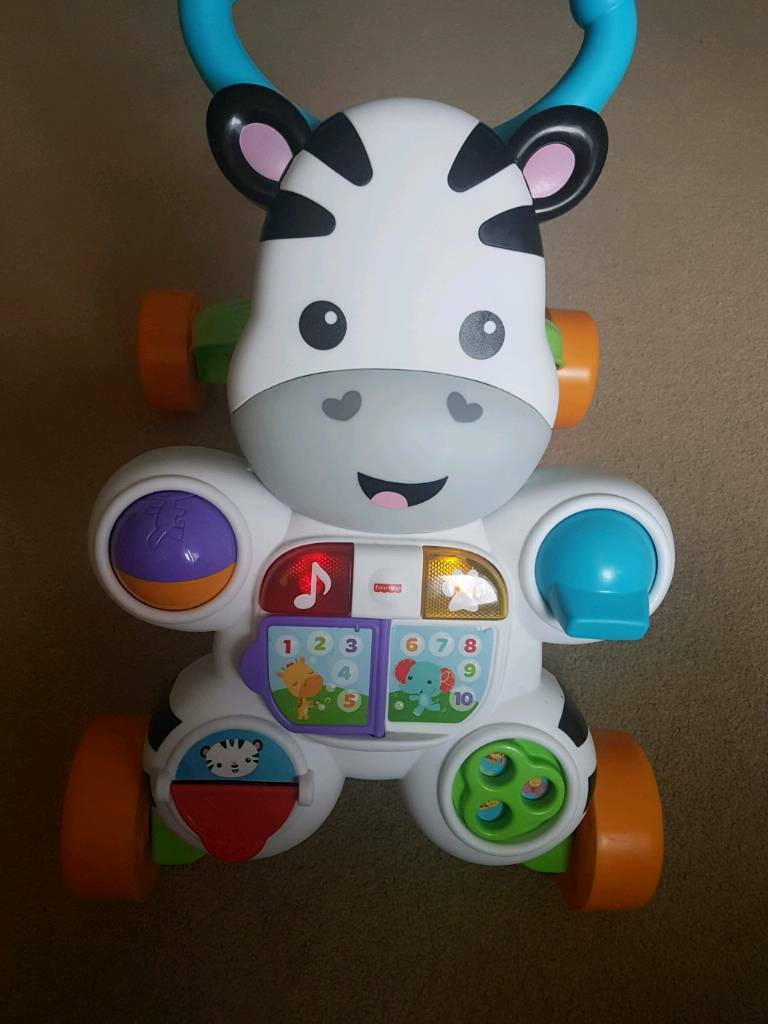 Almost new fisher price zebra walker