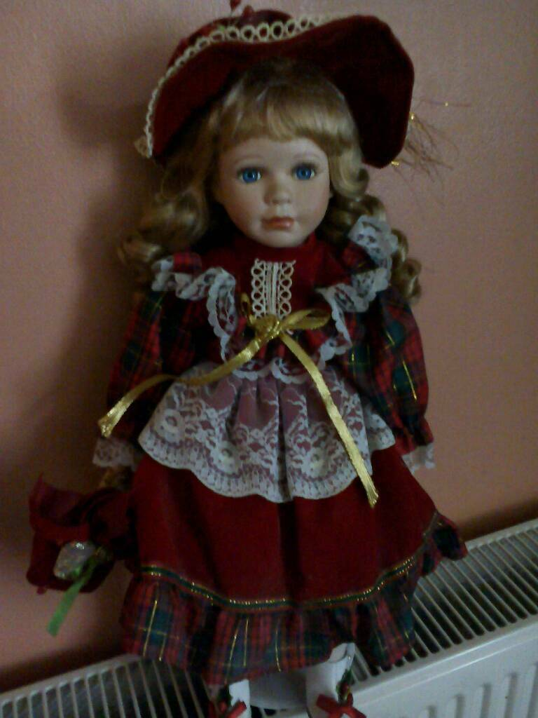 Leonardo collection porcelain doll with stand