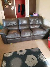 2x 3 seater brown leather sofas