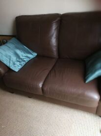 Two seater brown leather sofa excellent condition very little use