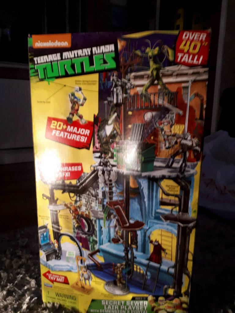 New In box. Ideal for Christmas ninja turtles sewer tower player with sounds