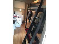 Black wooden double loft bed plus white Ikea chair £185