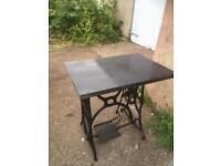 Cast iron table with granite top